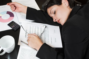 Chronic Sleep Deprivation woman sleep-on-desk