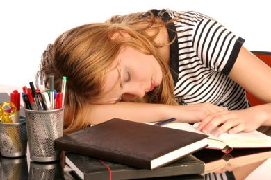 Narcolepsy Symptoms girl sleeping on books