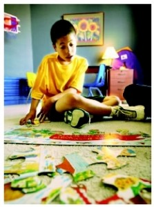 Can Melatonin Cure Autistic Children boy with jigsaw puzzles