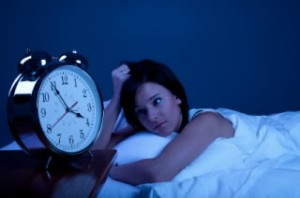 Melatonin for Sleep Uses and Abuses girl waking on bed