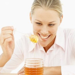Insomnia Treatment Methods Image 3 Woman eating honey