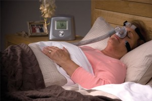 Merits and Demerits of CPAP Machines woman sleeping with CPAP machine